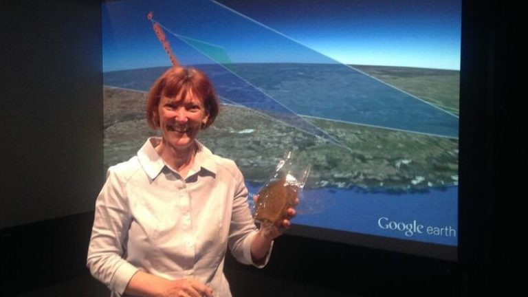 Carol Redford holding Dingle Dell meteorite recovered by the Fireballs in the Sky team