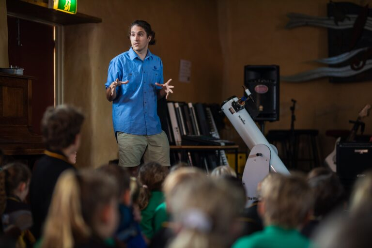 Astronomy guide talking to primary school students
